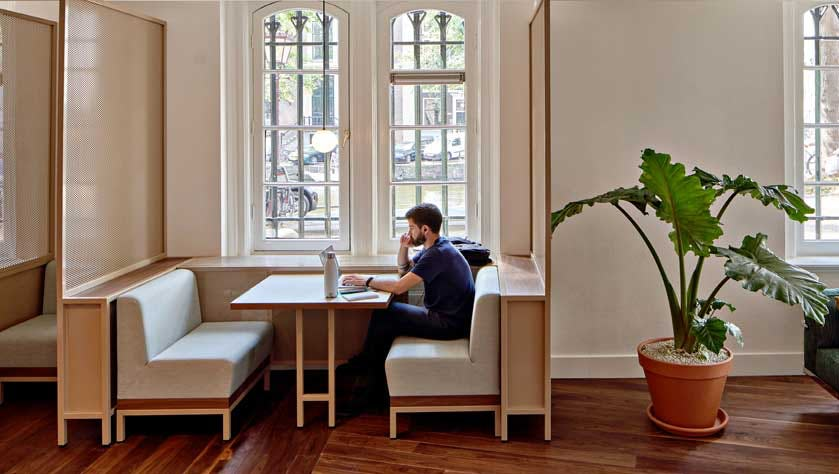 man thinking about how to start a business in a designer coworking space