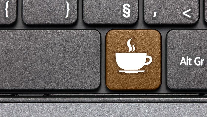 Coffee break. Brown hot key on computer keyboard.